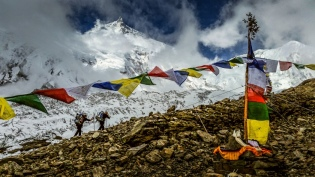 Climbers passing a Puja