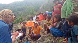 Taking a needs assessment report from the villagers at Bhirkuna
